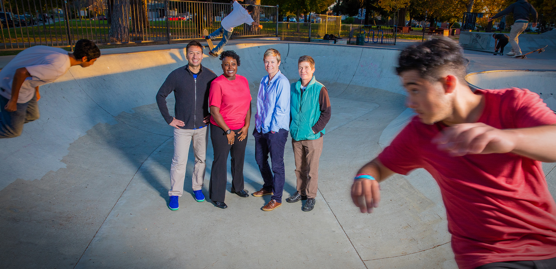 Photo of CSUEB kinesiology professors posing at a skateboarding park