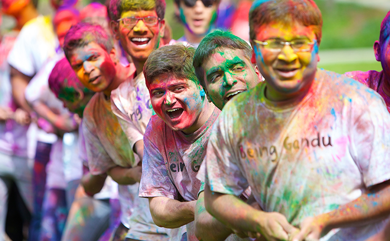 Students covered in colored power at the Holii festival