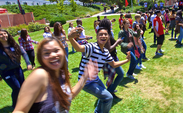 Students dance on the lawn