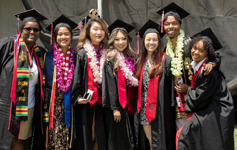 A group of students pose at graduation