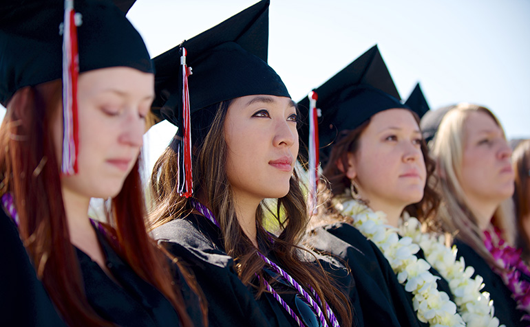 Students gaze into the crowd at graduation