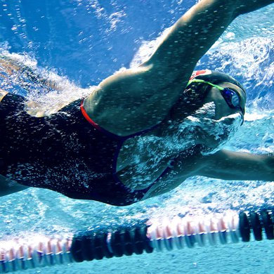 A female swimmer glides through the water