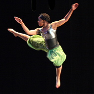 A dancer jumps in the air