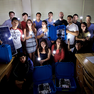 Students and professors display solar suitcases