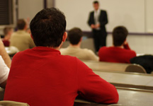 Photo of a student in a lecture hall.