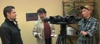Mustafa Ebrahimi, left, and Martin Wood explain their cameras to Henry Tennanbaum.