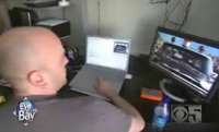 Man editing film on a computer.