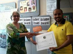 CSUEB American Language Program student Mohammed Alanazi (right) receives prize for Esther Briano Essay Award from Barbara Forsberg, ALP assistant director.