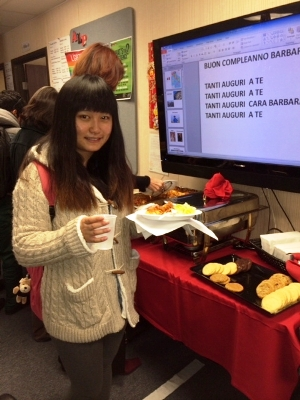 During one of the American Language Program's Special Hour events, ALP student Vivian Xu enjoys a slice of lasagna after learning about Italian culture and language.