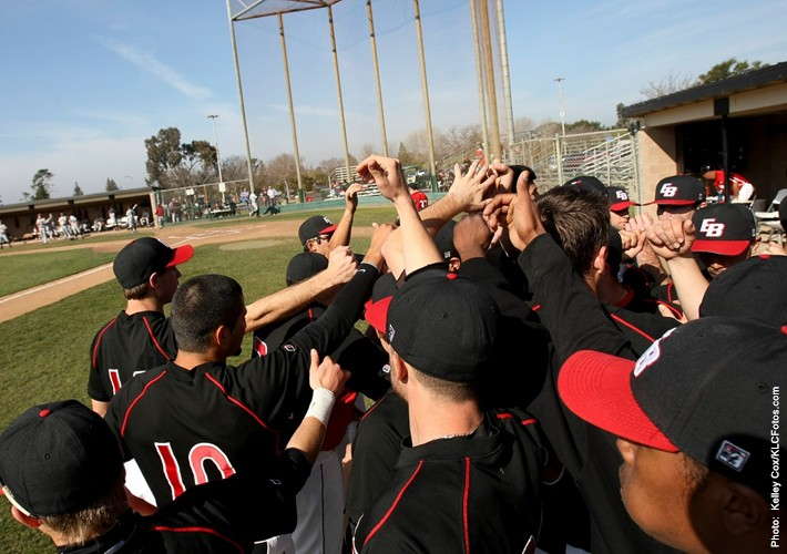Image of CSUEB baseball players in a dug out.