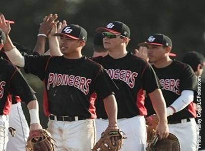 Image of three CSUEB baseball players high-fiving the rival team.