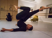Image of dancer Charles Williams stretching before a performance.