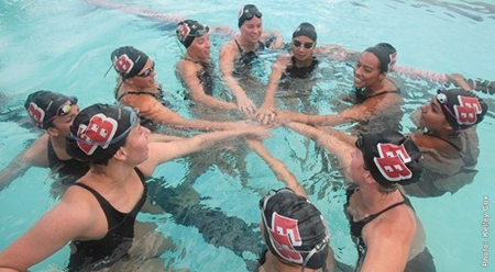 Photo of the 2012-13 CSUEB swim team in the pool.