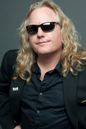 Head shot of Randy Monroe, CSUEB alumnus who is an award winning science teacher while also fronting a Van Halen tribute band