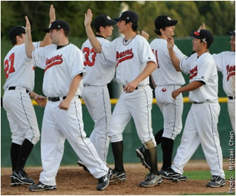 Photo of CSUEB Pioneer baseball team high-fiving each other. The Pioneer baseball coaching staff will conduct an open tryout on Sept. 28 from 3-5 p.m.