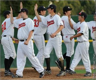 CSUEB Pioneer baseball team high-fiving each other