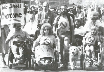 In a rally in Washington, D.C., before the passage of the ADA, demonstrators extend the frame of civil rights by incorporating slogans from the civil rights movement. (By: Courtesy of ist.hawaii.edu and Tom Olin)