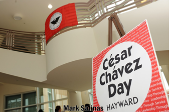 Image of the Hayward City Hall rotunda with a sign for the Cesar Chavez Day Teach-In.