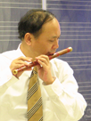 Chinese man playing the bamboo flute.