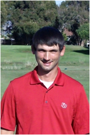 Photo of Chris Herzog, CSUEB golf player, at the golf course.