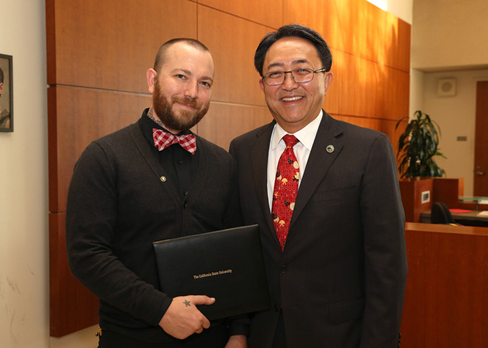 Cal State East Bay President Leroy M. Morishita nominated grad student David Fuller (left) for CSU scholar recognition. They were together at the Office of the Chancellor in Long Beach when Fuller was presented as an AT&T Scholar in late September. (By: CSU)