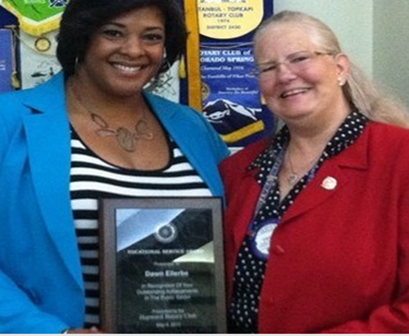 Photo of Dawn Ellerbe being presented with the Hayward Rotary Club award by Debby De Angelis.