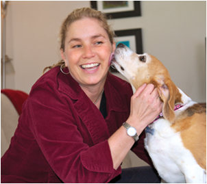 Associate Professor Dawna Komorosky with Carly, who she adopted from a beagle rescue group. (Image: Stephanie Secrest)