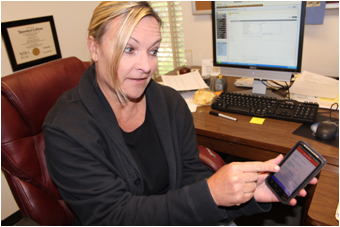 Assistant Political Science Professor Elizabeth Bergman demonstrates her new voter app created in partnership with Atwoodz, Inc. (By: Chase Thomas, The Pioneer)