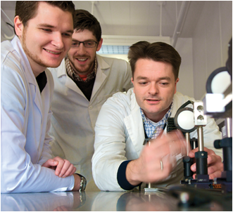 CSUEB students Trevor Billings, from left, and Keith Penney work in the lab alongside Assistant Professor Erik Helgren