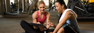 A personal trainer helps her client