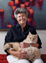 Photo of Janet Grove holding her cat.