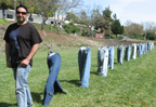 Artist, followed by row of jeans without bodies.