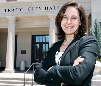 Photo of CSUEB alumna Jenny Haruyama  in front the Tracy, CA City Hall building.  She is the new Administrative Services Director.