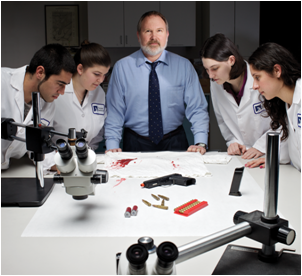 An expert in crime scene reconstruction and examination, faculty member Keith Inman introduces Cal State East Bay students to sample evidence and tools of the trade at a private crime lab in Hayward. (Image: Max Gerber)