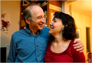 Saul Perlmutter with his wife and CSUEB Professor Laura Nelson (Image: Associated Press)