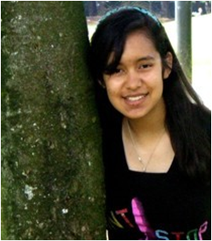 Photo of Lauren Lola next to a tree.