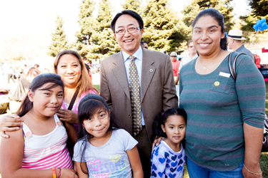 CSUEB President Leroy Morishita greets a local family at the Hayward Promise Neighborhood Community Festival. (By: Alex Lopez)