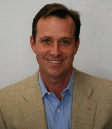 Image of CSUEB alumnus Mark Hennings '84, business administration, now CEO of Harris Supply Solutions