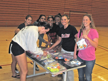 student-athletes assemble care packages