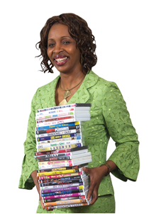 Stevina Evuleocha holding a stack of dvds (by: Jesse Cantley)