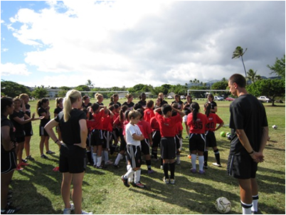 Women soccer players conducted a skills clinic for the U-10 team