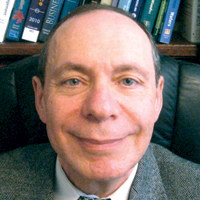 Headshot of CSUEB Management Professor Zinovy Radovilsky