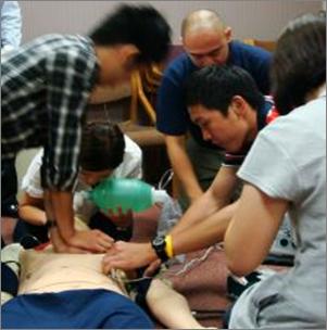 students working on a cardiac training dummy