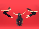 Man in wheelchair, two women in high jumps.