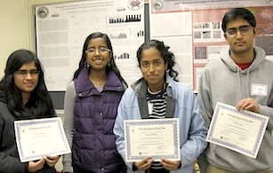 four high school students holding certificates