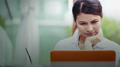 woman look at laptop screen