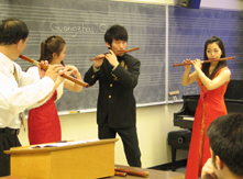 Assistant Dean and Music Professor Tao Geng of South China Normal University perform for music class.