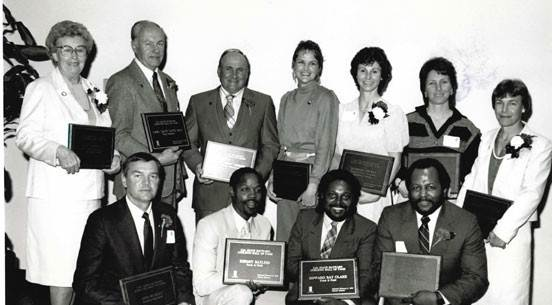 Photo of 11 former student-athletes being inducted into the CSUEB Hall of Fame.