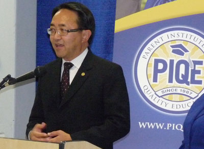 CSUEB President Leroy Morishita stands in front of a crowd of parents at the PIQE graduation. (Photo: Elias Barboza)