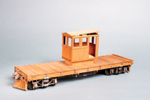 old, wooden, flatbed rail car.